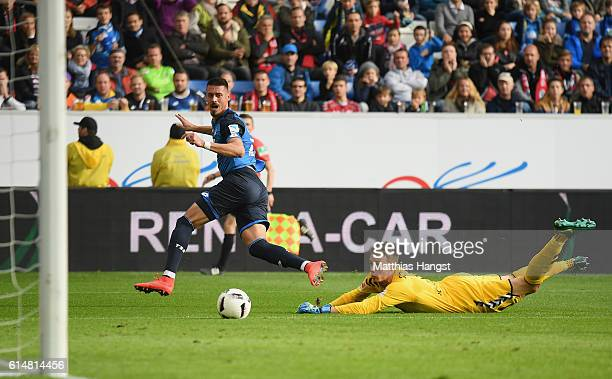 Sandro Wagner of Hoffenheim scores his team's first goal past goalkeeper Alexander Schwolow of Freiburg during the Bundesliga match between TSG 1899...