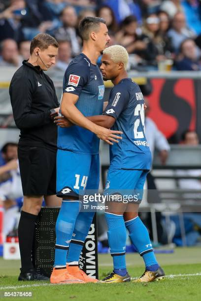 Sandro Wagner of Hoffenheim shakes hands with Serge David Gnabry of Hoffenheim during the Bundesliga match between TSG 1899 Hoffenheim and FC Schalke...