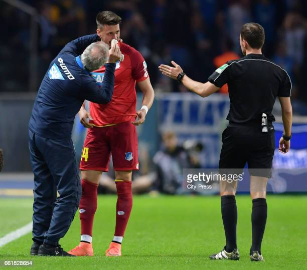 Sandro Wagner of the TSG 1899 Hoffenheim and referee Benjamin Brand during the game between Hertha BSC and TSG Hoffenheim on march 31 2017 in Berlin...