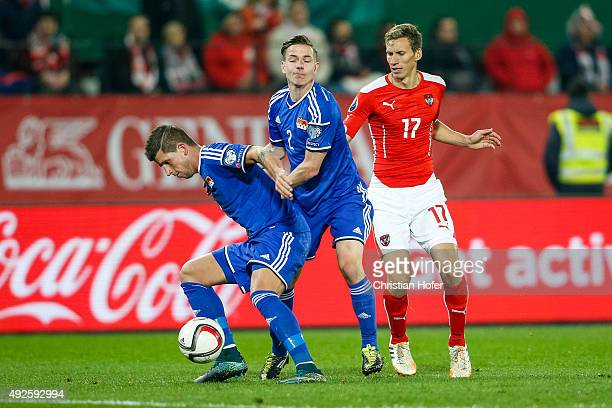 Sandro Wieser and Daniel Braendle of Liechtenstein compete for the ball with Florian Klein of Austria during the UEFA EURO 2016 Qualifier between...
