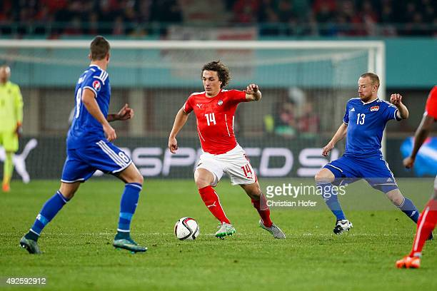Sandro Wieser and Martin Buechel of Liechtenstein compete for the ball with Julian Baumgartlinger of Austria during the UEFA EURO 2016 Qualifier...