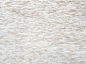 Sandstone brick wall texture and background