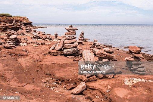 Sandstone Inuksuks along the rocky coast of North Cape, PEI