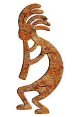 Kokopelli carved from sandstone and isolated on a white background.