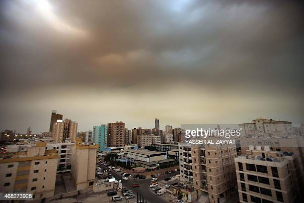 A sandstorm blows over Kuwait City on April 1 2015 The Kuwait Meteorological Department issued a sandstorm warning saying that the wind speed could...