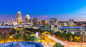Sandton city evening panorama with evening traffic. Sandton is the business, commercial and entertainment centre in South Africa. Sandton has become home to most of the major financial, consulting and