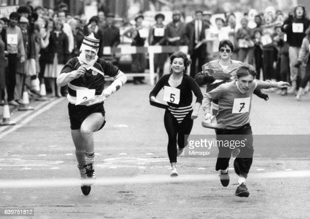 Sandwell Mail Pancake Race in west Bromwich High Street Number 222 gary Lockley of the MacDonalds Team all bandaged up on the way to winning the race...
