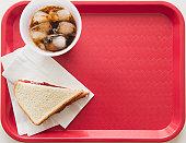Sandwich and soda on tray