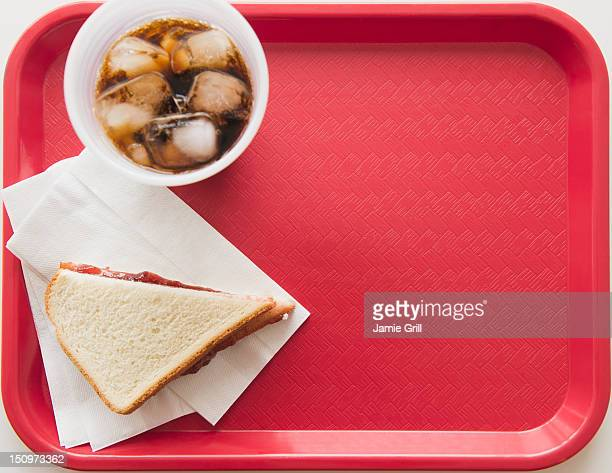 Sandwich and soda on tray