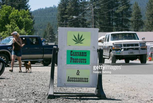 A sandwich board is seen outside the Sumpter Nugget marijuana dispensary July 2 2017 in the small historical gold mining town of Sumpter Oregon City...