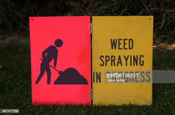 Sandwich board sign warning of workers spraying weeds with poison in Port Macquarie, New South Wales, Australia