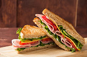 Sandwich bread tomato, lettuce and yellow cheese