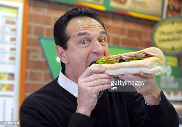 US sandwich maker Subway cofounder and chairman for the world the selfmade billionaire Fred DeLuca poses with a sandwich in a Parisian Subway...