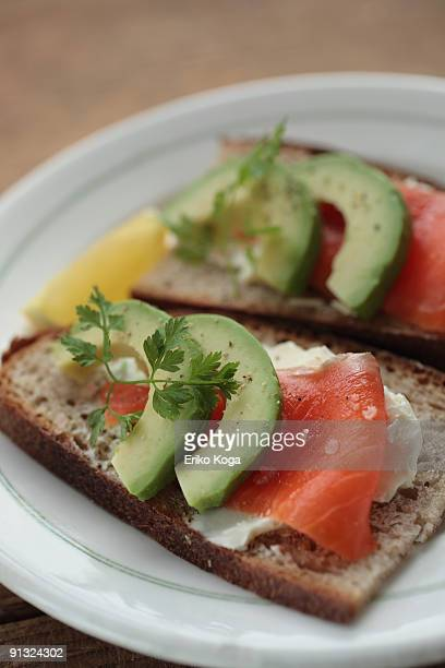 Sandwich with avocado, salmon and cream cheese