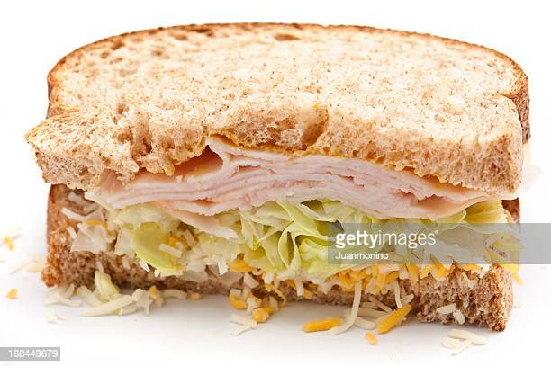 sandwich with half turkey and cheese