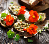 Canapes with herb pesto and edible nasturtium flowers