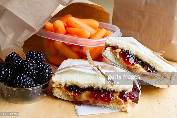 PB&J sandwich with some blueberries and carrots