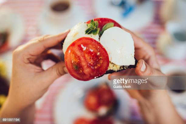 Sandwich with tomato and soft cheese.