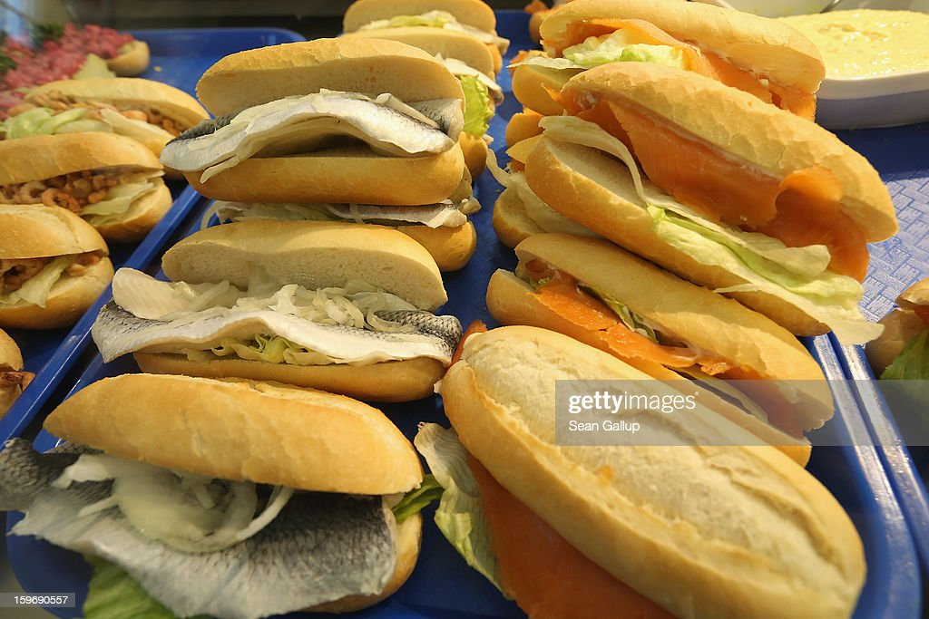 Sandwiches of salmon, matjes herring and other fish lie on display at a fishmonger's stand at the 2013 Gruene Woche agricultural trade fair on January 18, 2013 in Berlin, Germany. The Gruene Woche, which is the world's largest agricultural trade fair, runs from January 18-27, and this year's partner country is Holland. According to a recent study the average German consumes 1094 animals in his or her lifetime, including four cows, four sheep, 12 geese, 37 ducks, 46 turkeys, 46 pigs and 945 chickens.