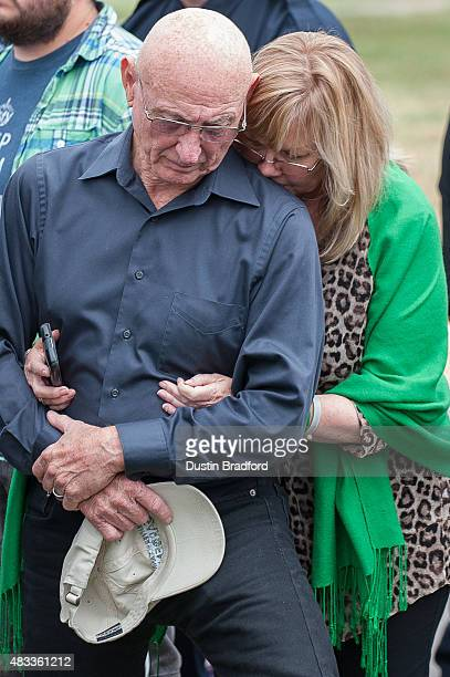 Sandy and Lonnie Phillips the parents of Jessica Ghawi a victim of the Aurora Colorado theater shooting comfort each other during a press conference...