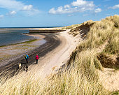 Sandy beach at low tide Budle Bay Northumberland England UK