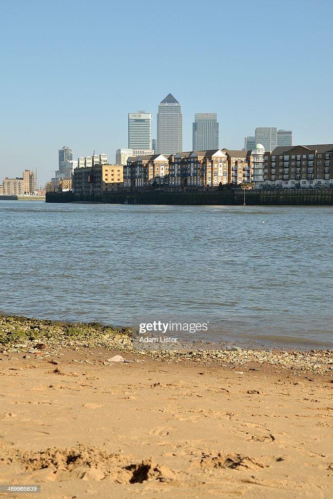 Sandy Beach & Canary Wharf : Stock Photo