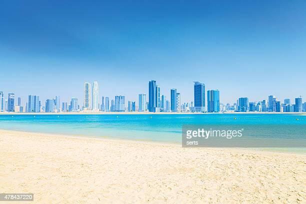 Sandy Beach, Sea and The City