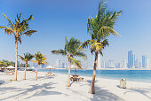 City view from Al Mamzar Beach Park in Dubai, UAE .Al Mamzar is located in the area of Deira, in the north-east of Dubai. The locality is bordered by the Persian Gulf to the north, Al Waheda to the we
