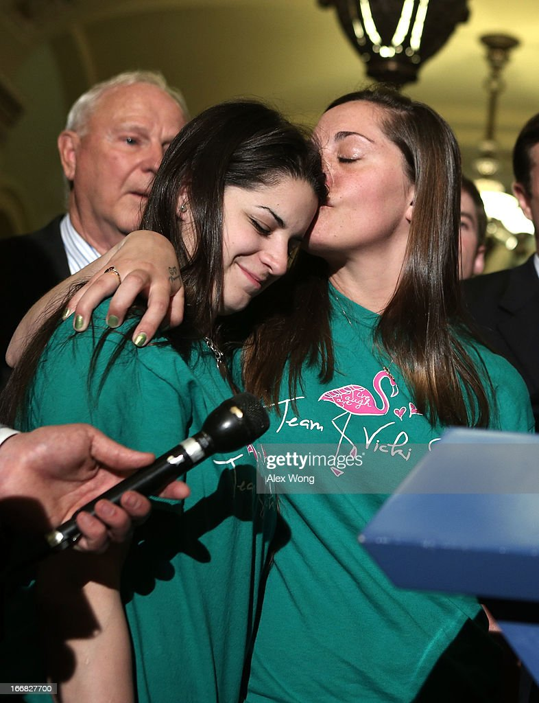 Sandy Hook victim Dawn Hochsprung's daughter Erica Lafferty (3rd L) kisses Sandy Hook victim Vicki Soto's sister Carlee Soto (2nd L), as Tucson, Arizona, shooting victim Bill Badger (L) looks on during a news briefing after a vote on the Senate floor April 17, 2013 on Capitol Hill in Washington, DC. The Senate has defeated a bipartisan proposal by Sens. Joe Manchin (D-WV) and Pat Toomey (R-PA) to expand background checks on firearms purchases and close the so-called gun show loophole.