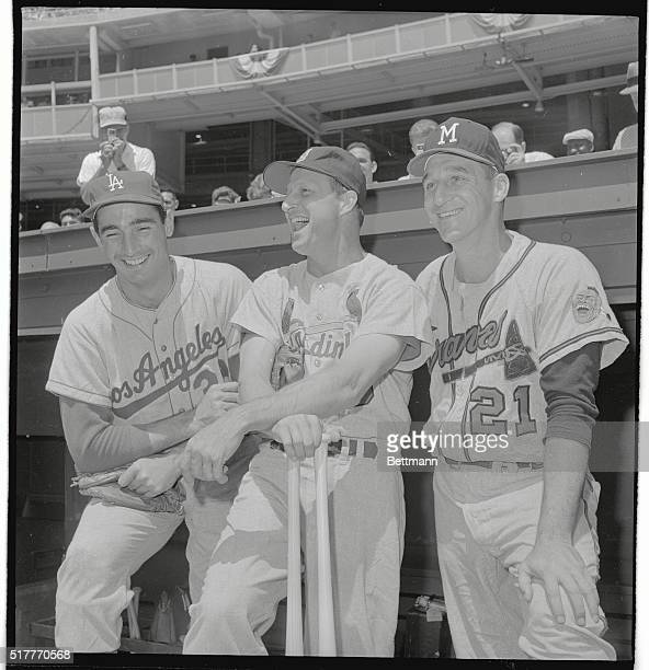 Sandy Koufax LA Stan Musial St Louis and Warren Spahn Boston Braves of the National League laugh it up before the AllStar Game held at DC Stadium