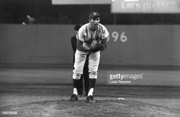 Sandy Koufax of the Los Angeles Dodgers focuses on home plate as he prepares to pitch during a game circa 19581966