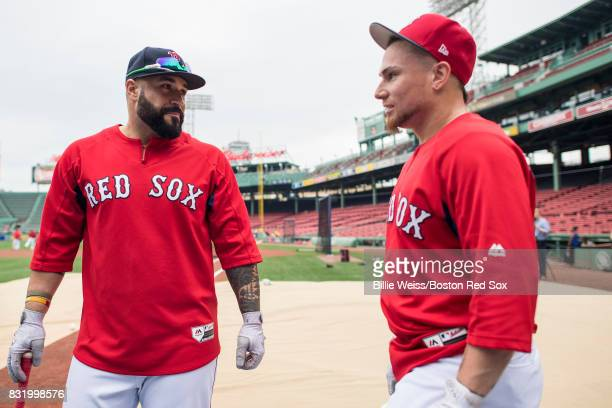 Sandy Leon and Christian Vazquez of the Boston Red Sox talk before a game against the St Louis Cardinals on August 15 2017 at Fenway Park in Boston...