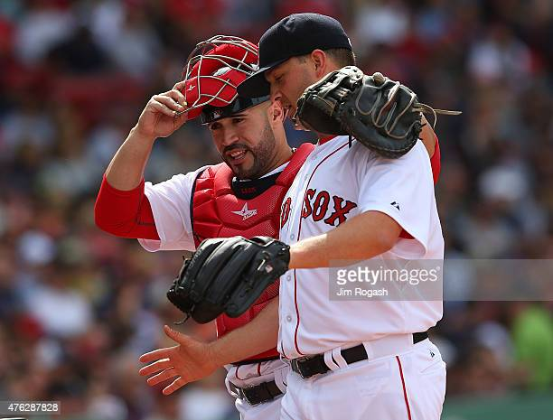 Sandy Leon of the Boston Red Sox and Steven Wright react in the seventh inning against the Oakland Athletics at Fenway Park on June 7 2015 in Boston...
