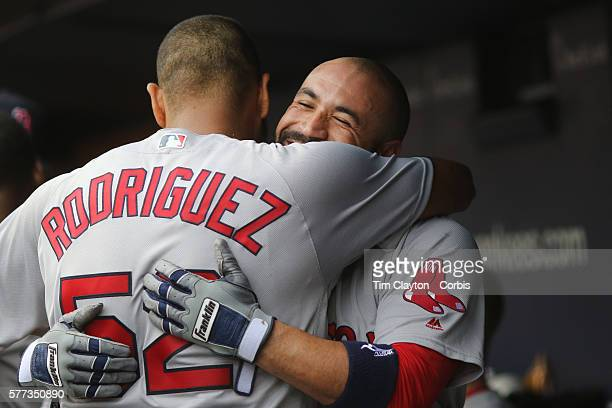 Sandy Leon of the Boston Red Sox is congratulated by pitcher Eduardo Rodriguez of the Boston Red Sox after hitting a three run home run in the sixth...