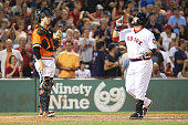 Sandy Leon of the Boston Red Sox reacts after hitting a solo home run as Trevor Brown of the San Francisco Giants looks on in the seventh inning...