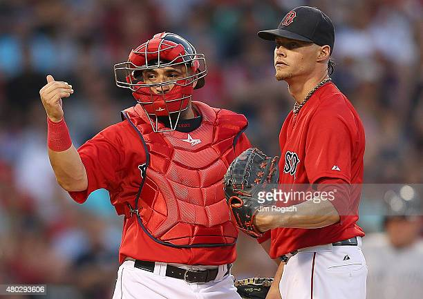 Sandy Leon of the Boston Red Sox signals to the dugout as Clay Buchholz reacts on the mound in the fourth inning New York Yankees at Fenway Park on...