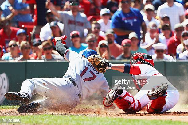 Sandy Leon of the Boston Red Sox tags out ShinSoo Choo of the Texas Rangers at home during the fourth inning at Fenway Park on July 4 2016 in Boston...