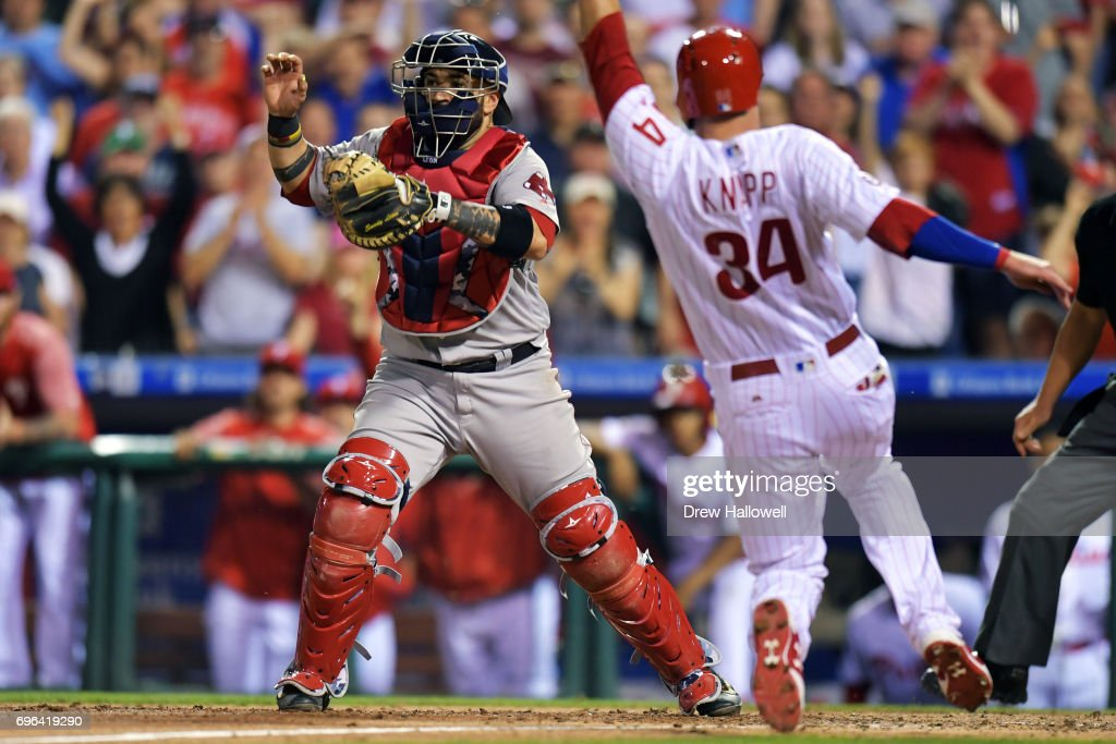Sandy Leon #3 of the Boston Red Sox waits for the throw from the outfield last Andrew Knapp #34 of the Philadelphia Phillies scores in the eighth inning at Citizens Bank Park on June 15, 2017 in Philadelphia, Pennsylvania. The Phillies won 1-0.