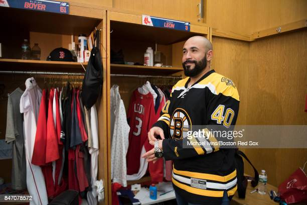 Sandy Leon of the Boston Red Sox wears a Tuuka Rask Boston Bruins jersey for the road trip Baltimore following a game against the Oakland Athletics...