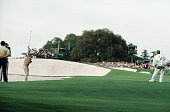 Sandy Lyle of Scotland hits a bunker shot on the 18th hole during the final round of the Masters on April 10th 1988 at The Augusta National Golf Club...