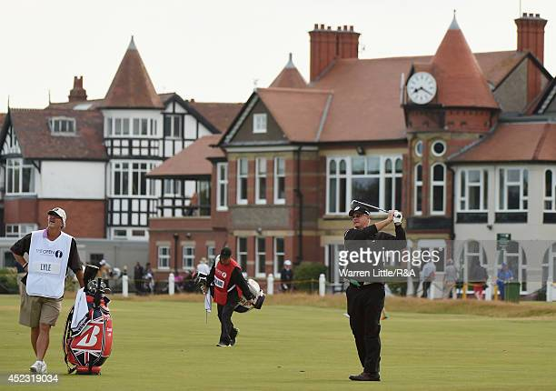 Sandy Lyle of Scotland hits his approach shot on the third hole as caddie Butch Wilhelm looks on during the second round of The 143rd Open...
