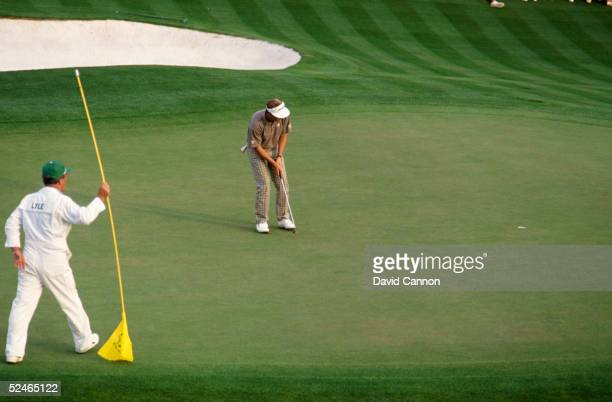 Sandy Lyle of Scotland holes his winning putt on the 18th green during the final round of the Masters held at The Augusta National Golf Club on April...