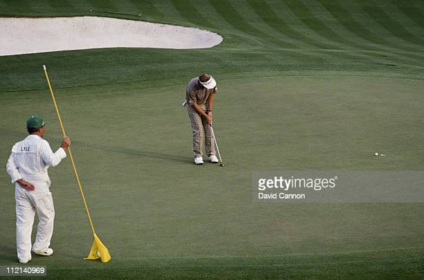 Sandy Lyle of Scotland holes out his winning putt on the 18th green during the final round of the US Masters Golf Tournament on 10th April 1988 at...