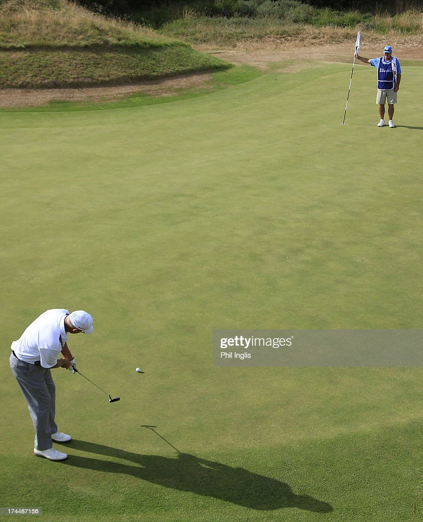 <a gi-track='captionPersonalityLinkClicked' href=/galleries/search?phrase=Sandy+Lyle&family=editorial&specificpeople=214683 ng-click='$event.stopPropagation()'>Sandy Lyle</a> of Scotland in action during the second round of The Senior Open Championship played at Royal Birkdale Golf Club on July 26, 2013 in Southport, United Kingdom.