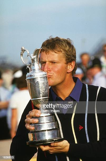 Sandy Lyle of Scotland kisses the Claret Jug after winning the British Open at Royal St Georges Golf Club in Sandwich Kent England Mandatory Credit...
