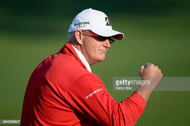 Sandy Lyle of Scotland reacts after a birdie on the second hole during the second round of the 2014 Masters Tournament at Augusta National Golf Club...
