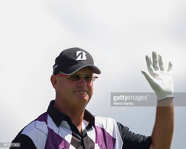 Sandy Lyle of Scotland waves to the gallery as he walks off the first tee during the final round of the Pacific Links Hawai'i Championship at Kapolei...