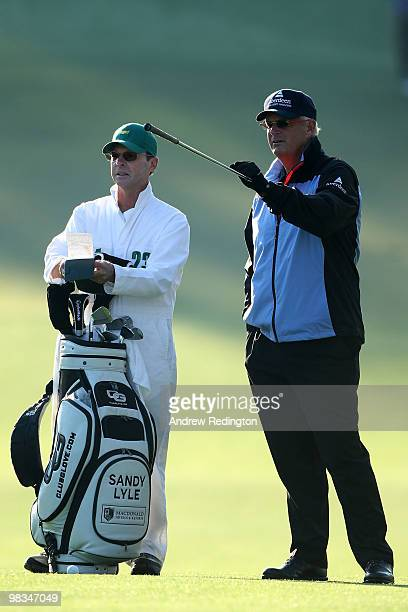 Sandy Lyle talks with his caddie Ken Martin on the first fairway during the second round of the 2010 Masters Tournament at Augusta National Golf Club...