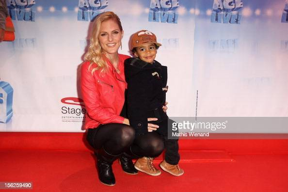Sandy Moelling with son Jaden attends the Ice Age Live gala premiere at ISS Dome on November 12 2012 in Duesseldorf Germany