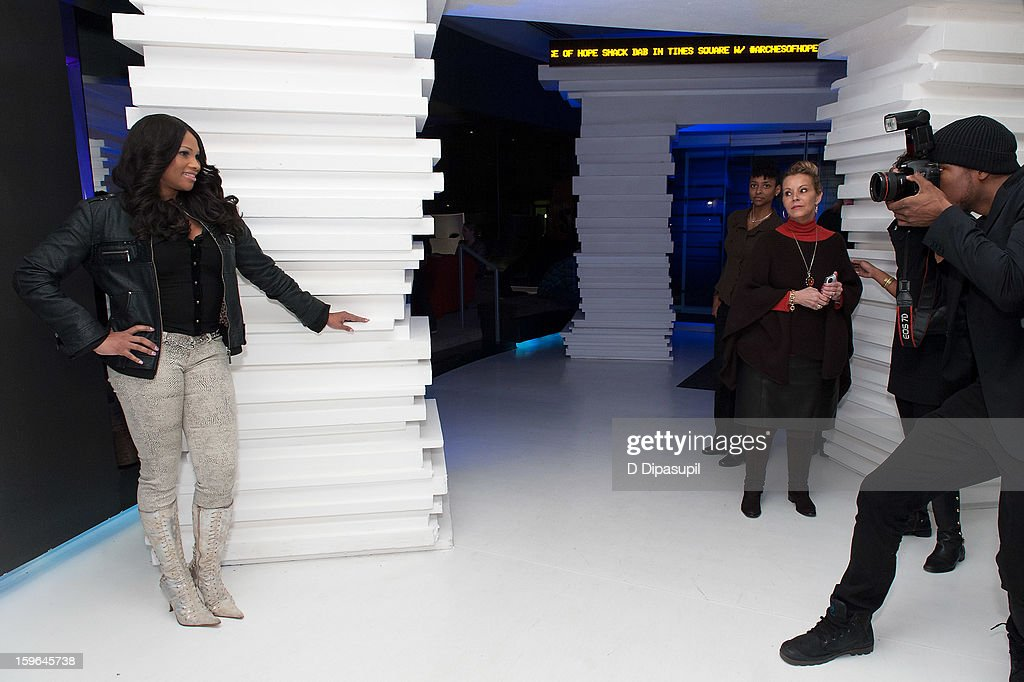 Sandy 'Pepa' Denton (L) attends the HIV/AIDS Awareness Art Installation unveiling at The Out NYC on January 17, 2013 in New York City.